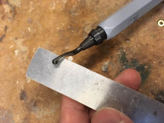 deburring scraper on melodica key